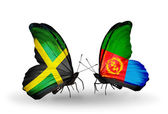 Butterflies with Jamaica and Eritrea flags on wings — Stock Photo