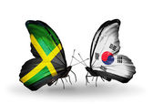 Butterflies with Jamaica and South Korea flags on wings — ストック写真
