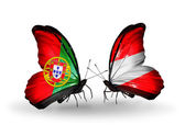 Butterflies with Portugal and Austria flags on wings — Stock Photo