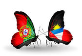 Butterflies with Portugal and Antigua and Barbuda flags on wings — Stock Photo
