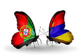 Butterflies with Portugal and Armenia flags on wings — Stock Photo