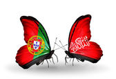 Butterflies with Portugal and Waziristan flags on wings — Stock Photo