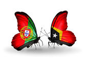 Butterflies with Portugal and East Timor flags on wings — Stock Photo