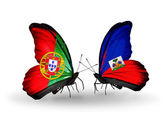 Butterflies with Portugal and Haiti flags on wings — Stock Photo