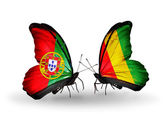 Butterflies with Portugal and Guinea flags on wings — Stock Photo