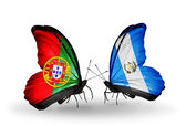Butterflies with Portugal and Guatemala flags on wings — Stock Photo