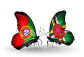 Butterflies with Portugal and Dominica flags on wings — Stok fotoğraf
