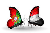 Butterflies with Portugal and Yemen flags on wings — Stock Photo