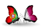 Butterflies with Portugal and Qatar flags on wings — Stock Photo