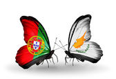 Butterflies with Portugal and Cyprus flags on wings — Stock Photo