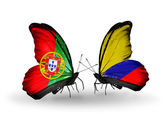Butterflies with Portugal and Columbia flags on wings — Stock Photo