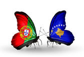Butterflies with Portugal and Kosovo flags on wings — Stock Photo