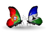 Butterflies with Portugal and Lesotho flags on wings — Stock Photo
