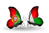 Butterflies with Portugal and Madagascar flags on wings — 图库照片
