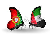 Butterflies with Portugal and UAE flags on wings — Stock Photo
