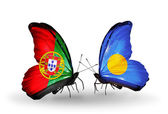 Butterflies with Portugal and Palau flags on wings — Stock Photo