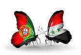 Butterflies with Portugal and Syria flags on wings — Stock Photo