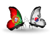 Butterflies with Portugal and South Korea flags on wings — Stock Photo