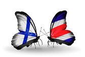 Motýli s příznaky finska a costa rica na křídlech — Stock fotografie