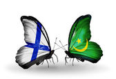Butterflies with Finland and Mauritania flags on wings — Stock Photo