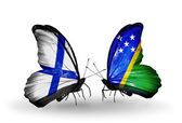Butterflies with Finland and Solomon Islands flags on wings — Stock Photo
