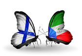 Butterflies with Finland and Equatorial Guinea flags on wings — Stock Photo