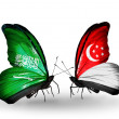 Butterflies with Saudi Arabiand Singapore flags on wings — Stockfoto #41393711
