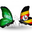 Butterflies with Saudi Arabiand Ugandflags on wings — Stockfoto #41393827