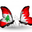 Butterflies with Lebanon and Bahrain flags on wings — Stockfoto #41393995