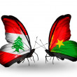 Butterflies with Lebanon and BurkinFaso flags on wings — Stockfoto #41394055