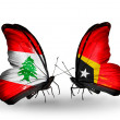 Butterflies with Lebanon and East Timor flags on wings — Stockfoto #41394095