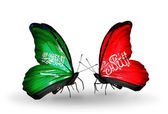 Butterflies with Saudi Arabia and Waziristan flags on wings — Stock Photo