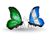 Butterflies with Saudi Arabia and Guatemala flags on wings — Stock Photo