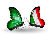 Butterflies with Saudi Arabia and Italy flags on wings — Stock Photo