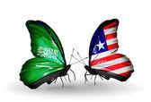 Motýli se Saúdskou Arábií a Libérie vlajek na křídlech — Stock fotografie