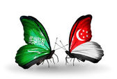 Butterflies with Saudi Arabia and Singapore flags on wings — Photo