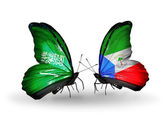 Butterflies with Saudi Arabia and Equatorial Guinea flags on wings — Stock Photo