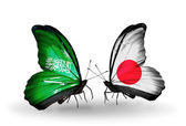 Butterflies with Saudi Arabia and Japan flags on wings — Stock Photo