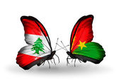 Butterflies with Lebanon and Burkina Faso flags on wings — Stock Photo