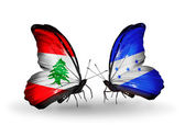 Butterflies with Lebanon and Honduras flags on wings — Photo