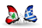 Butterflies with Lebanon and Greece flags on wings — Stock Photo
