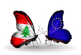 Butterflies with Lebanon and European Union flags on wings — Stock Photo