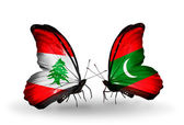 Butterflies with Lebanon and Maldives flags on wings — Stock Photo
