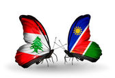 Butterflies with Lebanon and Namibia flags on wings — Stock Photo