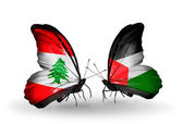 Butterflies with Lebanon and Palestine flags on wings — Stock Photo