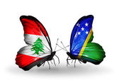 Butterflies with Lebanon and Solomon Islands flags on wings — Stock Photo