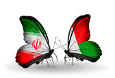 Two butterflies with flags of relations Iran and Madagascar — Zdjęcie stockowe