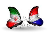 Butterflies with flags of Iran and Holland — Stock Photo