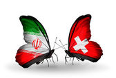 Butterflies with flags of Iran and Switzerland — Stock Photo