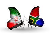 Butterflies with flags of Iran and South Africa — Stock Photo